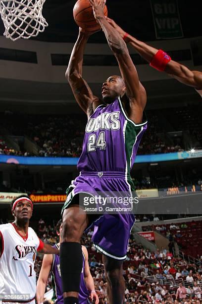 Desmond Mason of the Milwaukee Bucks dunks against Samuel Dalembert of the Philadelphia 76ers on April 18 2005 at the Wachovia Center in Philadelphia...