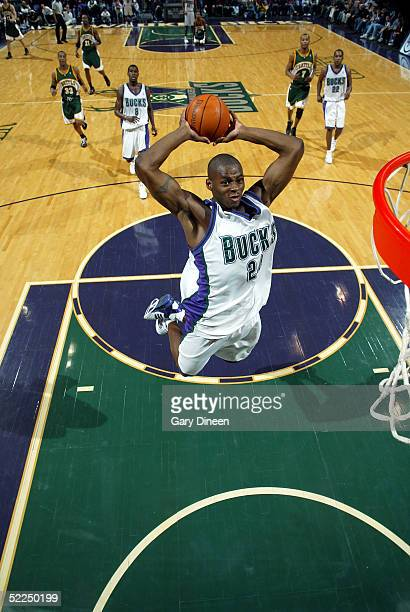 Desmond Mason of the Milwaukee Bucks dunks against the Seattle SuperSonics at the Bradley Center on February 27 2005 in Milwaukee Wisconsin NOTE TO...