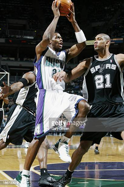 Desmond Mason of the Milwaukee Bucks goes to the basket against Tim Duncan of the San Antonio Spurs during the game at Bradley Center on March 11...