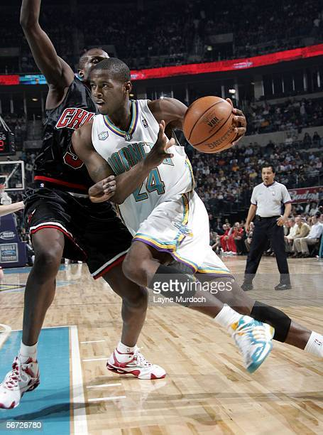 Desmond Mason of the New Orleans/Oklahoma City Hornets drives the ball on Luol Deng of the Chicago Bulls during a game on February 1 2006 at the Ford...