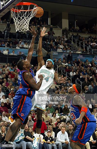 Desmond Mason of the New Orleans/Oklahoma City Hornets gets a shot off over Eddy Curry of the New York Knicks during NBA action February 10 2006 at...