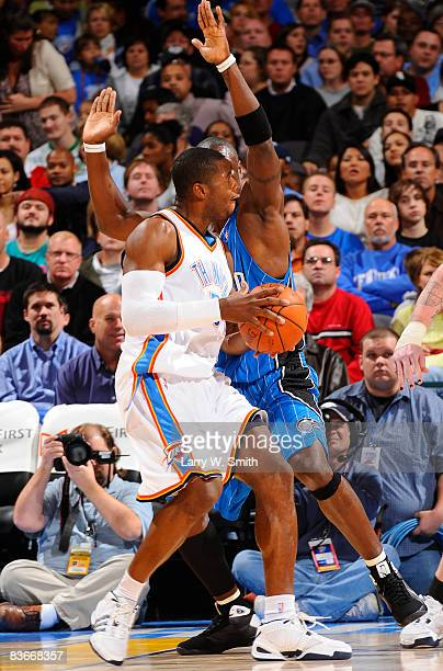 Desmond Mason of the Oklahoma City Thunder goes to the basket against Mickael Pietrus of the Orlando Magic at the Ford Center November 12 2008 in...