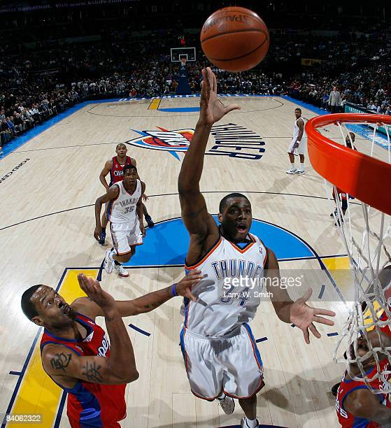 Desmond Mason of the Oklahoma City Thunder goes to the basket against Marcus Camby of the Los Angeles Clippers at the Ford Center December 16 2008 in...