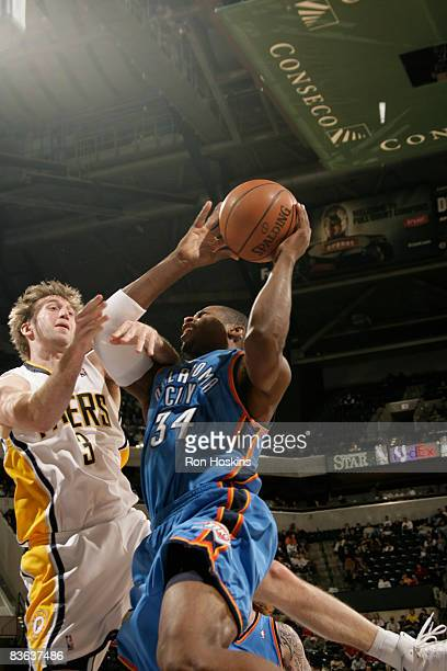 Desmond Mason of the Oklahoma City Thunder is fouled by Troy Murphy of the Indiana Pacers at Conseco Fieldhouse on November 10 2008 in Indianapolis...