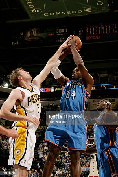 Desmond Mason of the Oklahoma City Thunder shoots over Troy Murphy of the Indiana Pacers at Conseco Fieldhouse on November 10 2008 in Indianapolis...