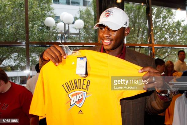 Desmond Mason of the Oklahoma City Thunder shops in the team merchandise store after the Oklahoma City NBA franchise unveiled its new Thunder logo...