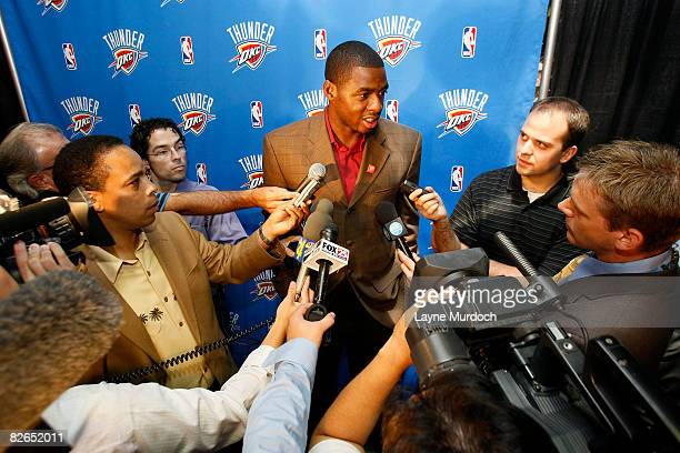 Desmond Mason of the Oklahoma City Thunder speaks to media after the Oklahoma City NBA franchise unveiled its new Thunder logo and colors at a press...