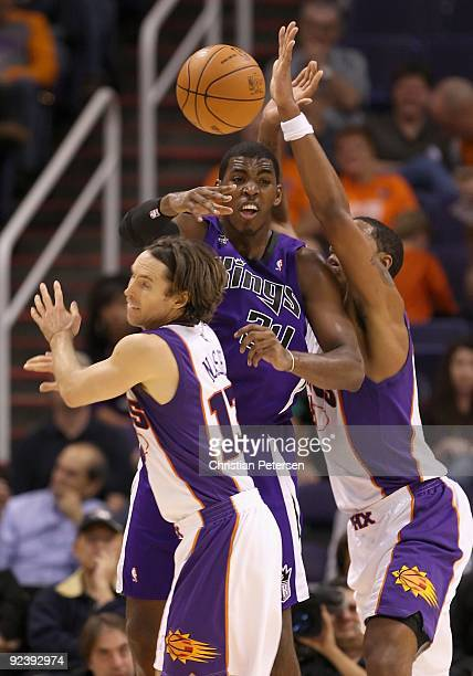 Desmond Mason of the Sacramento Kings passes the ball under pressure from the Phoenix Suns during the NBA preseason game at US Airways Center on...