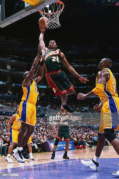Desmond Mason of the Seattle SuperSonics goes up for a dunk against the Los Angeles Lakers at the Staples Center on March 11 2001 NOTE TO USER User...