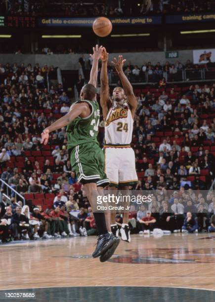 Desmond Mason, Small Forward and Shooting Guard for the Seattle SuperSonics attempts a 3 point jump shot as Paul Pierce of the Boston Celtics jumps...