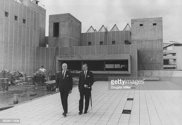 Desmond Plummer Leader of Greater London Council with senior architect Geoffrey Horsefall walking on one of the new open air sculpture courts at...