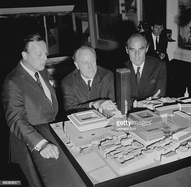 Desmond Plummer Leader of the Greater London Council with architects Dennis Lennon and Herbert Fitzroy Robinson inspecting a model of the proposed...