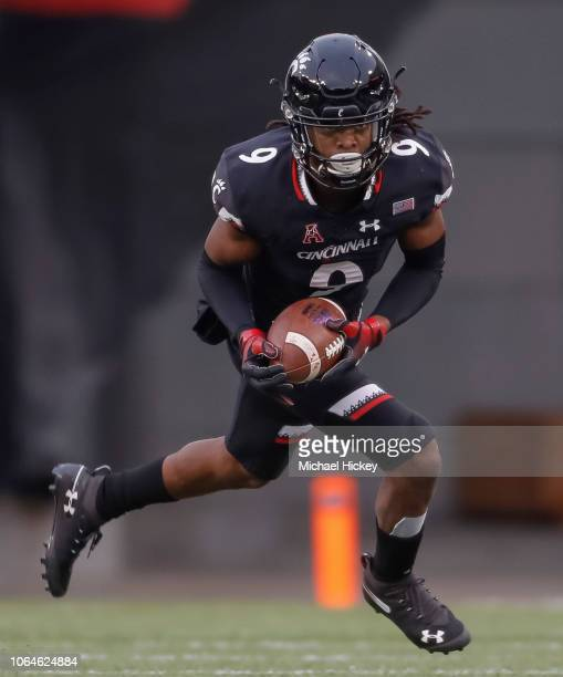 Desmond Ridder of the Cincinnati Bearcats runs the ball back after a fumble recovery during the game against the East Carolina Pirates at Nippert...
