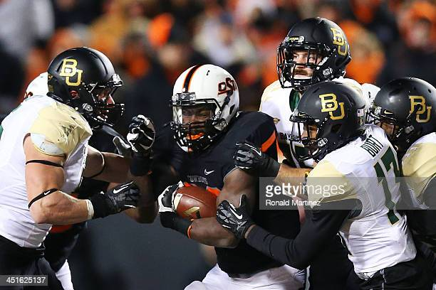 Desmond Roland of the Oklahoma State Cowboys carries the ball against the Baylor Bears in the first quarter at Boone Pickens Stadium on November 23...