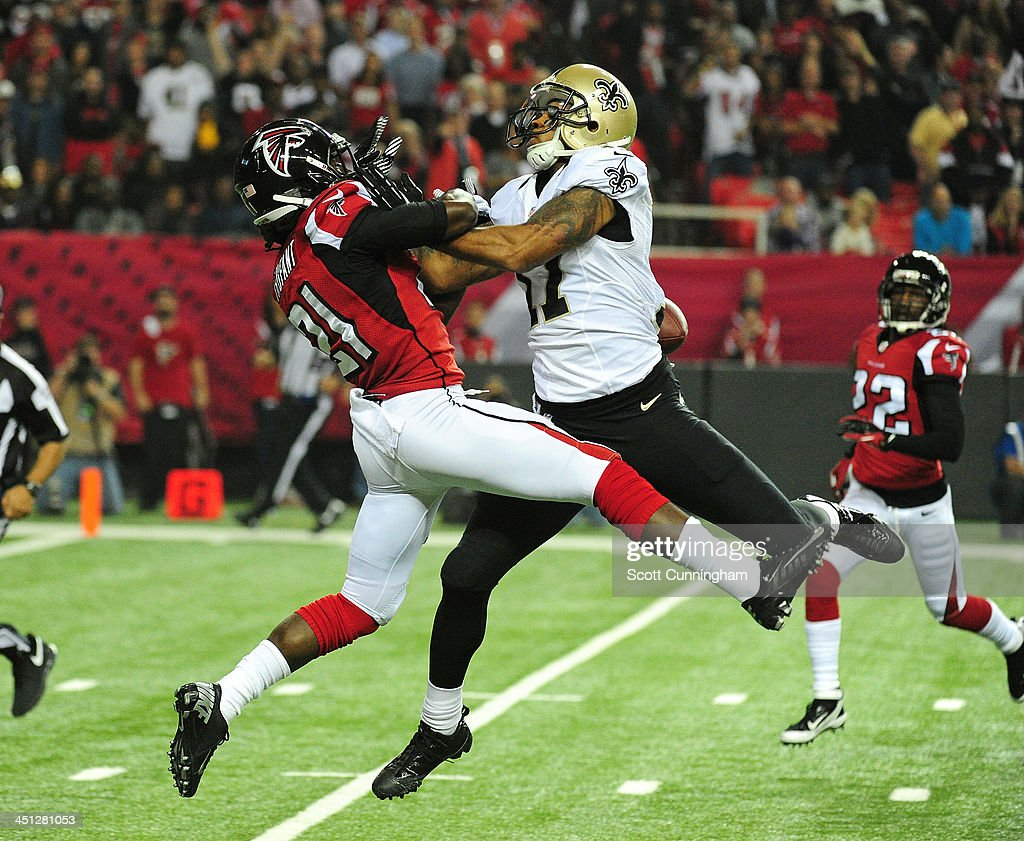 Desmond Trufant #21 of the Atlanta Falcons breaks up a pass intended for Robert Meachem #17 of the New Orleans Saints at the Georgia Dome on November 21, 2013 in Atlanta, Georgia.