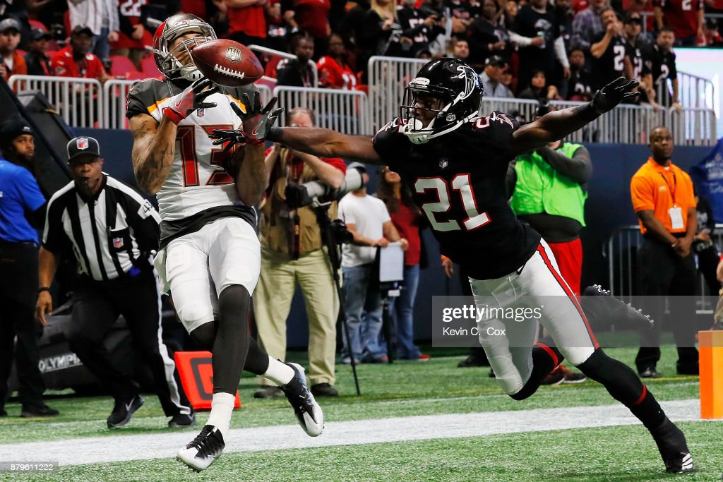 Desmond Trufant #21 of the Atlanta Falcons breaks up a pass intended for Mike Evans #13 of the Tampa Bay Buccaneers during the first half at Mercedes-Benz Stadium on November 26, 2017 in Atlanta, Georgia.