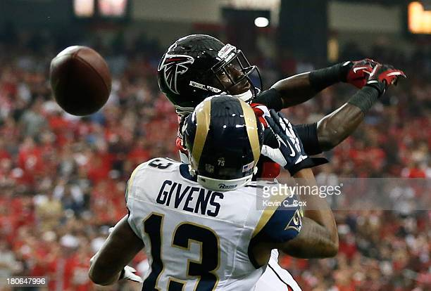 Desmond Trufant of the Atlanta Falcons breaks up a touchdown reception intended for Chris Givens of the St Louis Rams at Georgia Dome on September 15...