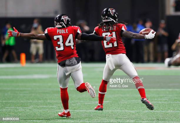 Desmond Trufant of the Atlanta Falcons celebrates with Brian Poole after intercepting Aaron Rodgers of the Green Bay Packers during the second...