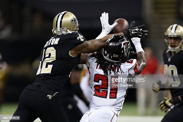 Desmond Trufant of the Atlanta Falcons intercepts a pass intended for Marques Colston of the New Orleans Saints during the first quarter of a gameat...