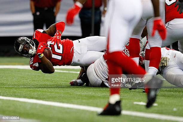 Desmond Trufant of the Atlanta Falcons is tackled by Tony Jefferson of the Arizona Cardinals on a run during the first half at the Georgia Dome on...