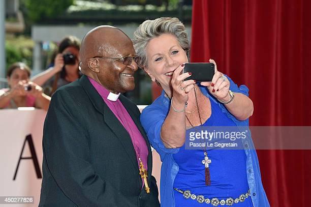 Desmond Tutu and Francoise Laborde attend a photocall during the 54th MonteCarlo Television Festival at Grimaldi Forum on June 8 2014 in MonteCarlo...