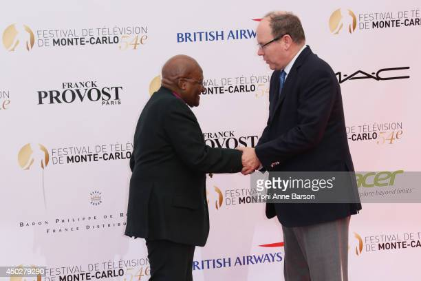 Desmond Tutu and HSH Prince Albert II of Monaco attends the 'Children of the Light' World Premiere at the Grimaldi Forum on June 8 2014 in MonteCarlo...