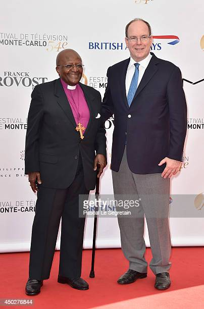 Desmond Tutu and Prince Albert II of Monaco attend a photocall during the 54th MonteCarlo Television Festival at Grimaldi Forum on June 8 2014 in...