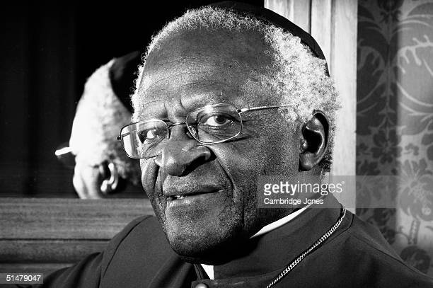 Desmond Tutu poses during a photo call held on March 12 2004 at Dean's Yard in London