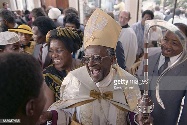 Desmond Tutu smiles after being appointed Anglican Archbishop of Cape Town in 1986 His wife Leah is at his side