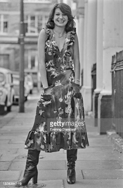 Desna Bell Briggs wearing a patterned floral dress and boots, UK, 30th September 1974.