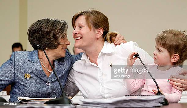 Desni Crock of Marietta Ohio is hugged by US Rep Jan Schakowsky as Crock's threeyearold daughter Bridget looks on after she told their stories about...