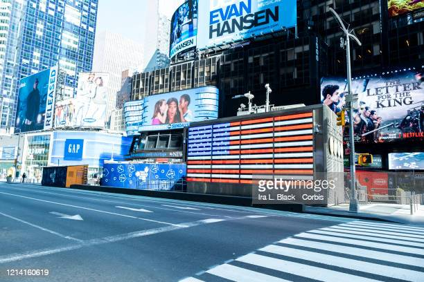 A desolate 8th Avenue Times Square on a Sunday afternoon with the American Flag behind it The streets were mostly empty on the same day that New York...