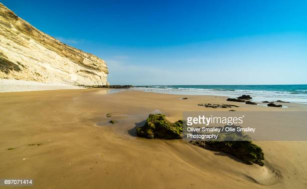 desolate azure blue moroccan coast - near agadir, west morocco - agadir stock pictures, royalty-free photos & images