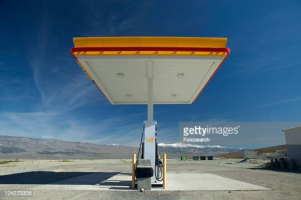 A desolate Gas Station with a sign reading Self