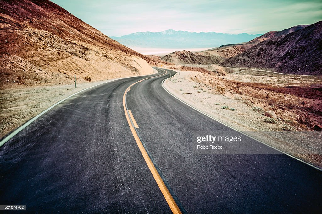 A desolate, winding, paved highway in Death Valley, CA : Stock Photo
