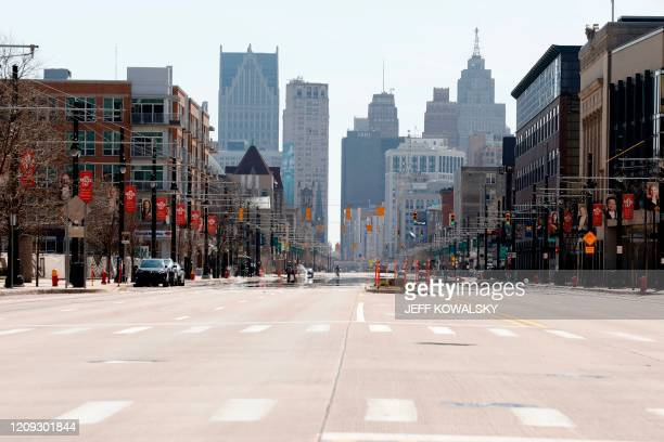 Desolate Woodward Avenue in the middle of the day is viewed in Detroit, Michigan on April 6, 2020. - More than 10,000 people have died of coronavirus...