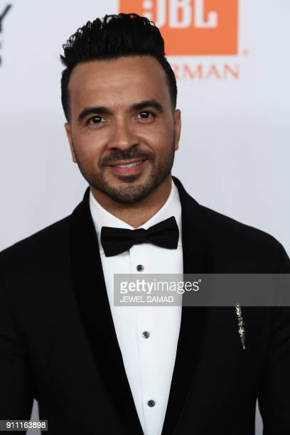 Despacito Singer Luis Fonsi arrives for the traditionnal Clive Davis party on the eve of the 60th Annual Grammy Awards on January 28 in New York /...