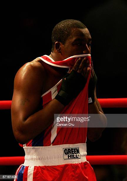 Despair for Anderson Emmanuel of Barbados after defeat in the Men's Hevyweight 91 kg Semifinal bout during the boxing at the Melbourne Exhibition...