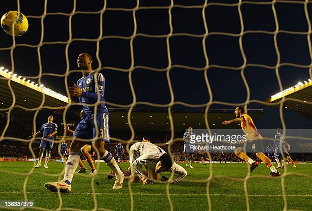 Despair for Ashley Cole and Petr Cech of Chelsea as Stephen Ward of Wolverhampton Wanderers scores their first goal during the Barclays Premier...