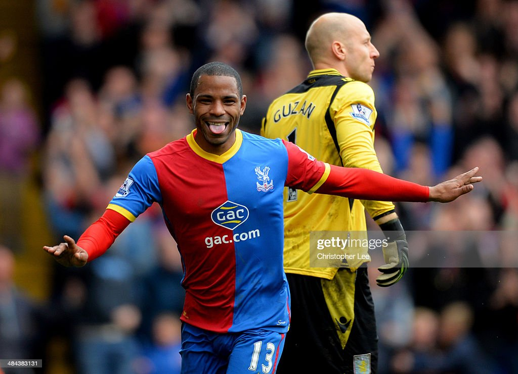 Despair for Brad Guzan of Aston Villa as Jason Puncheon of Crystal Palace celebrates as he scores their first goal during the Barclays Premier League match between Crystal Palace and Aston Villa at Selhurst Park on April 12, 2014 in London, England.