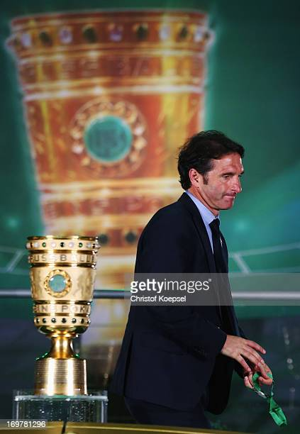 Despair for Bruno Labbadia head coach of Vfb Stuttgart as he walks past the trophy after defeat in the DFB Cup Final match between FC Bayern Muenchen...
