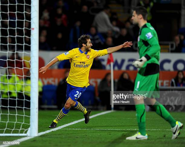 Despair for David Marshall of Cardiff City as Mathieu Flamini of Arsenal scores their second goal during the Barclays Premier League match between...