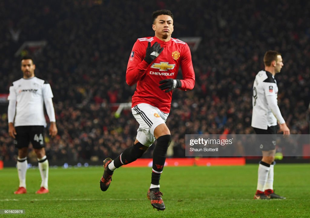 Despair for Derby County players as Jesse Lingard of Manchester United (C) celebrates as he scores their first goal during the Emirates FA Cup Third Round match between Manchester United and Derby County at Old Trafford on January 5, 2018 in Manchester, England.