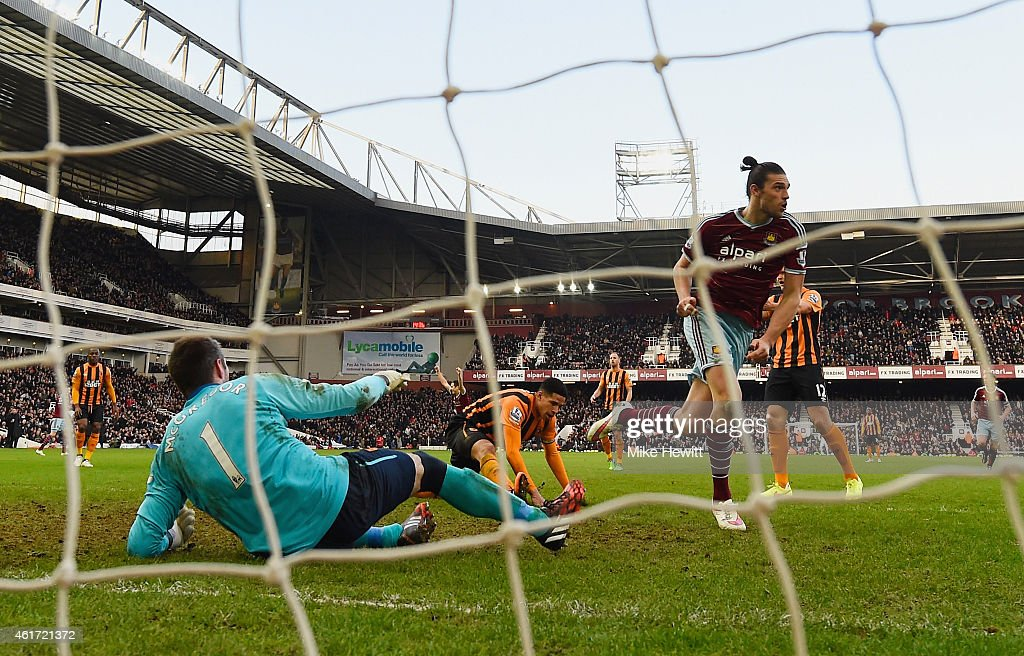 Despair for goalkeeper Allan McGregor of Hull City as Andy Carroll of West Ham United celebrates scoring their first goal during the Barclays Premier League match between West Ham United and Hull City at Boleyn Ground on January 18, 2015 in London, England.