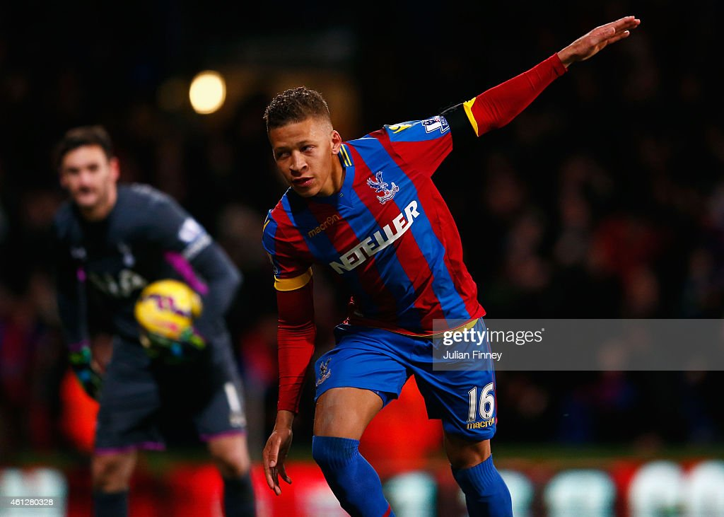 Despair for Hugo Lloris of Spurs (L) as Dwight Gayle of Crystal Palace celebrates scoring their first and equalisin goal from a penalty during the Barclays Premier League match between Crystal Palace and Tottenham Hotspur at Selhurst Park on January 10, 2015 in London, England.
