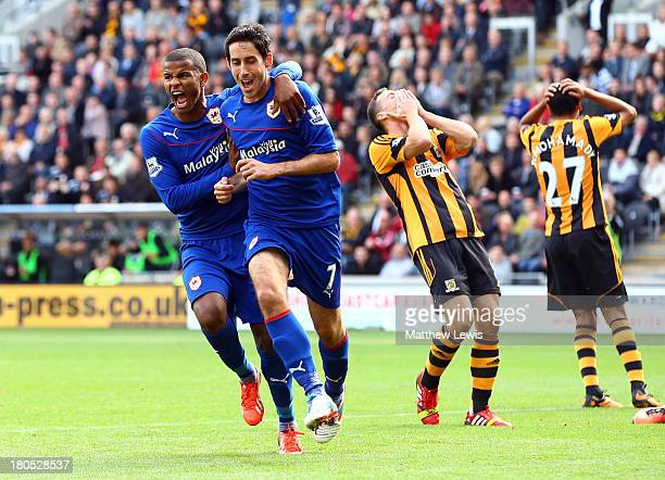 Despair for Hull City as Peter Whittingham of Cardiff City celebrates with Fraizer Campbell as he scores their first goal during the Barclays Premier...