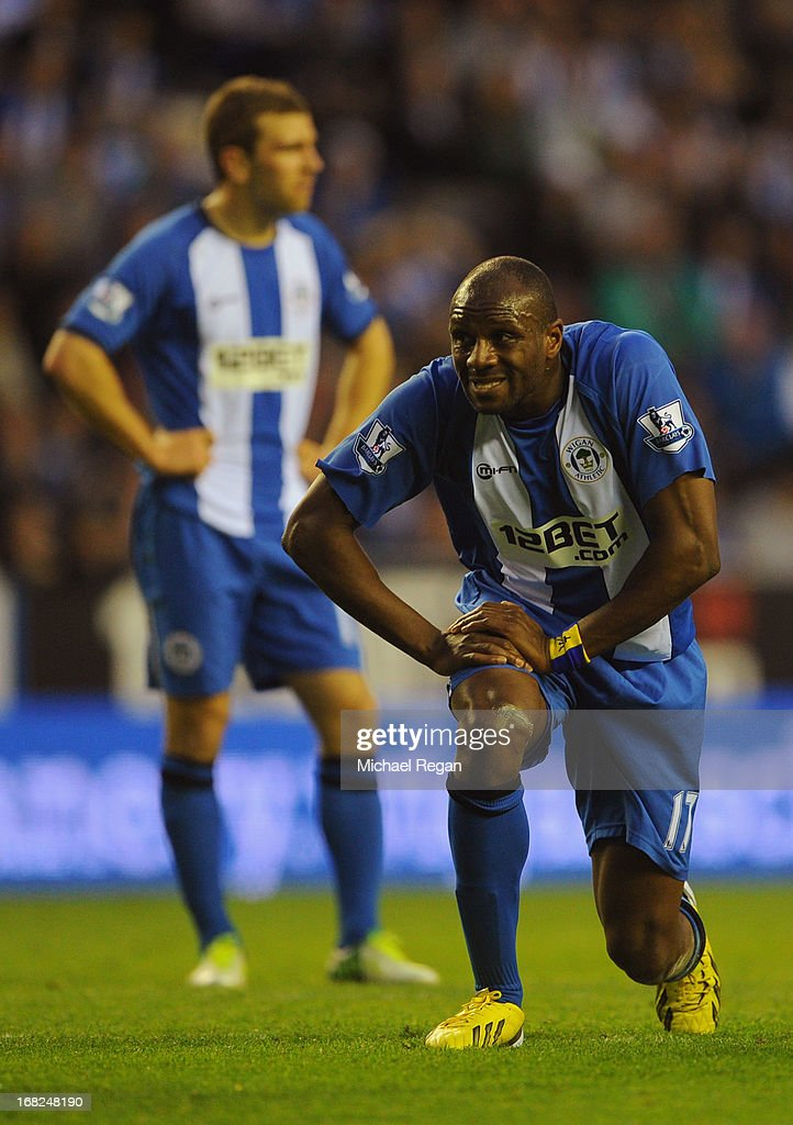 Despair for James McArthur and Emmerson Boyce of Wigan Athletic as Itay Shechter of Swansea City (not pictured) scores their second goal during the Barclays Premier League match between Wigan Athletic and Swansea City at DW Stadium on May 7, 2013 in Wigan, England.