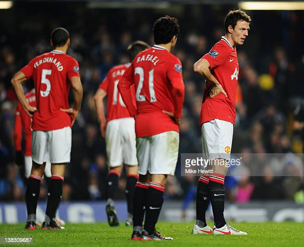Despair for Jonny Evans Rafael da Silva and Rio Ferdinand of Manchester United as David Luiz scores Chelsea's third goal during the Barclays Premier...