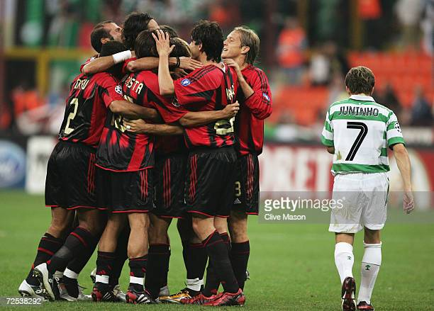 Despair for Juninho of Celtic as Milan celebrate during the UEFA Champions League Group F match between AC Milan and Celtic at the San Siro on...