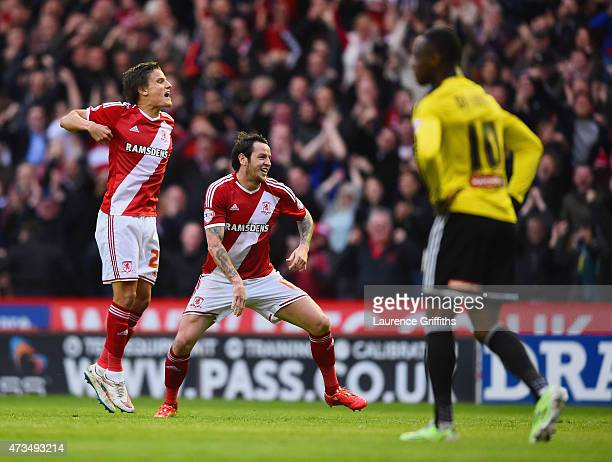 Despair for Moses Odubajo of Brentford as Lee Tomlin of Middlesbrough celebrates with Jelle Vossen as he scores their first goal during the Sky Bet...